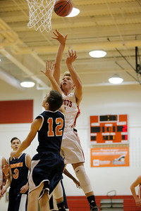 Bethesda Chrisitan High School forward Liam McCurry  (21) with the jump shot over Crosspointe Christian Academy High School guard Johnny Janke (12) during the game between Crosspointe Christian Academy vs Bethesda Christian at  Bethesda Christian High School in Brownsburg,IN. (Jeff Brown/Flyer Photo)