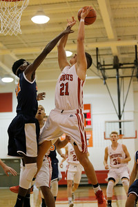 Bethesda Chrisitan High School forward Liam McCurry  (21) has his shot blocked by Crosspointe Christian Academy High School center Mitchell Sanders (21) during the game between Crosspointe Christian Academy vs Bethesda Christian at  Bethesda Christian High School in Brownsburg,IN. (Jeff Brown/Flyer Photo)