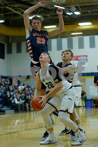Tri-West High School forward Jake Hill  (20) with the head fake to draw the found from Harrison High School power forward Bobby Dearing (23) during the game between Harrison vs Tri-West  at  Tri-West High School in Lizton,IN. (Jeff Brown/Flyer Photo)