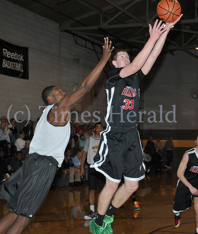 . The Blazer\'s Conner Jack attempts a 2 point shot.  Wednesday, April 9, 2014.  Photo by Adrianna Hoff/Times Herald Staff.