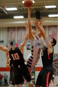 Danville High School guard Connor Jones (11) throws up the shot between Southmont High School freshman Hannah Thompson (10) and sophomore Claire Remley (33)  for two during the game between Southmont vs Danville at  Danville High School in Danville,IN. (Jeff Brown/Flyer Photo)