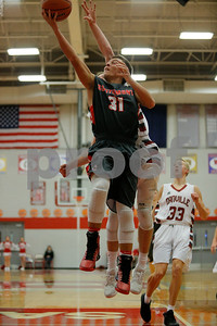 Southmont High School junior Reese Vancleave (31) goes up for the lay up and is fouled by Danville High School forward Zach Callahan (22) during the game between Southmont vs Danville at  Danville High School in Danville,IN. (Jeff Brown/Flyer Photo)