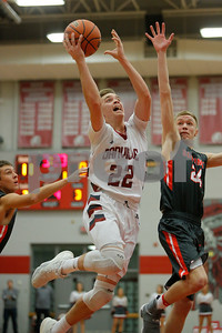 Danville High School forward Zach Callahan (22) goes up and around Southmont High School sophomore Justin Howard (24) for two during the game between Southmont vs Danville at  Danville High School in Danville,IN. (Jeff Brown/Flyer Photo)