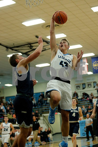 Cascade High School forward Dalton DuBois (C)  (43) goes up an over Tri-West High School guard Tyler Watson  (13) for two during the game between Tri-West vs Cascade at  Cascade High School in Clayton,IN. (Jeff Brown/Flyer Photo)