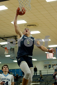 Tri-West High School forward Peyton Hendershot  (5) with the slam dunk off the fast break during the game between Tri-West vs Cascade at  Cascade High School in Clayton,IN. (Jeff Brown/Flyer Photo)