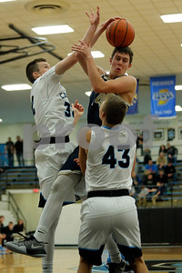 Tri-West High School forward Nick Rabe  (14) is fouled by Cascade High School forward Benson Walker (32) during the game between Tri-West vs Cascade at  Cascade High School in Clayton,IN. (Jeff Brown/Flyer Photo)