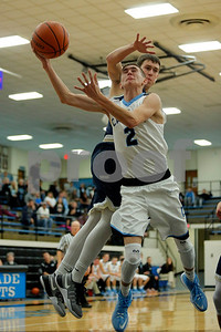 Cascade High School forward Jayden Hopper (C)  (2) is fouled by Tri-West High School forward Nick Rabe  (14)during the game between Tri-West vs Cascade at  Cascade High School in Clayton,IN. (Jeff Brown/Flyer Photo)