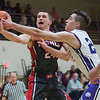 JAY YOUNG | THE GOSHEN NEWS<br /> Goshen High senior Mitchell Walters, left, battles for control of a rebound against Elkhart Christian Academy junior Weston Sage during their game Tuesday night in Elkhart.