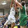 JAY YOUNG | THE GOSHEN NEWS<br /> Fairfield sophomore Cordell Hofer (12) battles for a rebound during the Falcons' quarterfinal game against Eastside in the NECC Basketball Tournament Wednesday night at Fairfield.