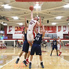 JAY YOUNG | THE GOSHEN NEWS<br /> Goshen High senior Mitchell Walters (24) skies for a rebound over Elkhart Central's Andrew Salmon (44) and Jacob Kaiser during their game in the 2016 Holiday Basketball Tournament hosted by Goshen High.