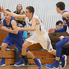 JAY YOUNG | THE GOSHEN NEWS<br /> Bethany Christian junior Seth Brenneman, center, takes off down court as he swoops in to steal the ball while Triton's Caden Marr, left, and Grant Johnson, right, give chase during their game Tuesday night at Bethany.