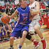 JAY YOUNG | THE GOSHEN NEWS<br /> West Noble sophomore Trevor Franklin (23) is harassed by Goshen High senior Michael Pinarski while trying to drive to the basket during their game Tuesday night at Goshen High School.