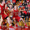 CHAD WEAVER | THE GOSHEN NEWS<br /> Nicholas Rensberger, Elijah Gum-Hales, and Cody Collyer of Westview and Trey Phillips of Central Noble battle for position on a rebound during the first half of Friday night's 2A basketball sectional at Westview.