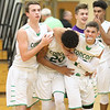 JAY YOUNG | THE GOSHEN NEWS<br /> Saint Joseph senior Muhammad Shabazz (13) can only watch as Concord players, from left, Matt Auger, Denzel Halliburton and Brandon Emerick celebrate their last second victory over Saint Joseph as they walk off the court following their game Tuesday evening in Dunlap.