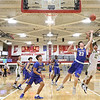 JAY YOUNG | THE GOSHEN NEWS<br /> East Noble sophomore Brent Cox (23) battles Fairfield sophomore Cordell Hofer (12) for a rebound during their game in the 2016 Holiday Basketball Tournament hosted by Goshen High.