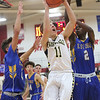 JAY YOUNG   THE GOSHEN NEWS<br /> Fairfield junior Luke Stephens (11) gets between East Noble defenders Ali Ali (2) and Hayden Jones, left, as he gets to the basket during their game in the 2016 Holiday Basketball Tournament hosted by Goshen High.