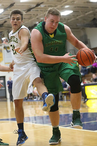 JAY YOUNG | THE GOSHEN NEWS Eastside senior Jacob Thompson (44) pulls a rebound away from Fairfield senior Zach Munn (31)  during their quarterfinal game in the NECC Basketball Tournament Wednesday night at Fairfield.