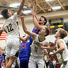 JAY YOUNG | THE GOSHEN NEWS<br /> West Noble senior Larry Nickolson (35) flips up a shot over the outstretched hand of Fairfield sophomore Cordell Hofer (12)  while Luke Stephens (11) gets into rebounding position during their 3A sectional championship game on Saturday night.