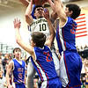 JAY YOUNG | THE GOSHEN NEWS<br /> Fairfield senior Brady Willard (10) takes on a triple team by West Noble defenders Nick Knepper (21), Larry Nickolson (35) and Trevor Franklin during their 3A sectional championship game on Saturday night.