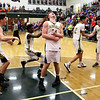 JAY YOUNG | THE GOSHEN NEWS<br /> Fairfield junior Shandon Miller lets out a scream while teammates celebrate behind him following their 3A sectional championship victory over West Noble on Saturday night in Syracuse.