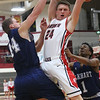 JAY YOUNG | THE GOSHEN NEWS<br /> Goshen High senior Mitchell Walters (24) pulls down a rebound between Elkhart Central's Michael Boone and Amarion Bartlett (1) during their game in the 2016 Holiday Basketball Tournament hosted by Goshen High.