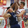 JAY YOUNG | THE GOSHEN NEWS<br /> Arms get tangled as Goshen High senior Eliot Nafziger (34) battles Elkhart Central junior Jacob Kaiser and others for a rebound during their game in the 2016 Holiday Basketball Tournament hosted by Goshen High.