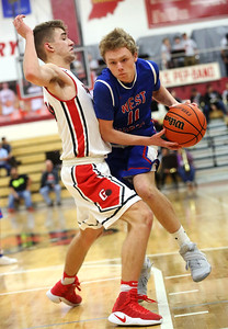 JAY YOUNG | THE GOSHEN NEWS West Noble sophomore Takota Weigold (11) pushes into Goshen High senior Eliot Nafziger to create space during their game Tuesday night at Goshen High School.