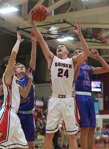 JAY YOUNG | THE GOSHEN NEWS Goshen High senior Mitchell Walters (24) pulls down an offensive rebound during the Redhawks' game against West Noble on Tuesday night at Goshen High School.