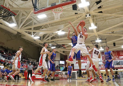 JAY YOUNG | THE GOSHEN NEWS Goshen High senior Mitchell Walters (24) rips a rebound away from West Noble senior Larry Nickolson (35) during their game on Tuesday night at Goshen High School.