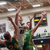 JAY YOUNG | THE GOSHEN NEWS<br /> Wawasee junior Jacob Hand (22) spits Tippecanoe Valley defenders Alec Craig (24) and Alex Salas-Morrison (30) as he gets off a shot during the quarterfinals of the 3A sectional Tuesday night at Wawasee High School in Syracuse.