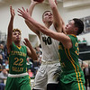 JAY YOUNG | THE GOSHEN NEWS<br /> Wawasee junior Trevon Coleman (40) muscles for position between Tippecanoe Valley defenders DeSean Heckman (22) and Alex Salas-Morrison (30) during the quarterfinals of the 3A sectional Tuesday night at Wawasee High School in Syracuse.