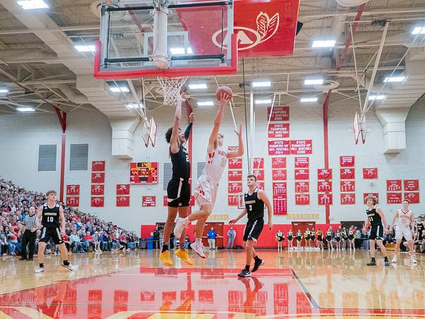 Westview Warriors forward Luke Miller (31) shoots a basket against Churubusco Eagles forward  Landen Jordan (23) during the Friday night game at Westview High School in Topeka.