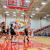 Westview Warriors guard Drew Litwiller (25) shoots a basket during the Friday night game at Westview High School in Topeka.