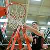 NorthWood Panthers guard Jason Borkholder (21) cuts the net after winning the NorthWood 3A Sectional Championship game Saturday evening at NorthWood High School.