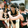 NorthWood Panthers forward Josh Stratford  (31), guard Jamarr Jackson (12), guard Brock Flickeringer (4), and guard Cooper Wiens (20) react after winning the NorthWood 3A Sectional Championship game Saturday evening at NorthWood High School.