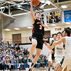NorthWood Panthers guard Cade Brenner (3) goes up for a basket during the NorthWood 3A Sectional Championship game Saturday evening at NorthWood High School.