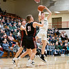 Wawasee Warriors guard Austin Miller (32) shoots a basket against NorthWood Panthers guard Josh Stratford (31) during the NorthWood 3A Sectional Championship game Saturday evening at NorthWood High School.
