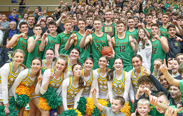 The Northridge Raiders celebrate their 60-38 victory over the Warsaw<br /> tigers with their fans after Saturday night's championship game at North<br /> Side gym in Elkhart.