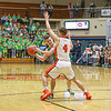 Northridge junior Carter Stoltzfus (12) tries to pass the ball around<br /> Warsaw senior Blake Marsh (4) during Saturday night's Elkhart Sectional<br /> championship game.