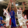 JAY YOUNG | THE GOSHEN NEWS<br /> Goshen High's Bryant Robinson (44) and Mitchell Walters (24) fight for a rebound with West Noble senior Larry Nickolson (35) during their game Tuesday night at Goshen High School.