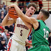 JAY YOUNG | THE GOSHEN NEWS<br /> NorthWood senior Vincent Miranda (5) pushes his way past Concord senior Brandon Emerick (10) during their game Thursday night in Nappanee.