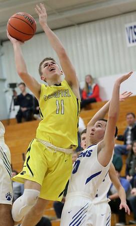 JAY YOUNG   THE GOSHEN NEWS<br /> Fairfield junior Luke Stephens (11) finds a path to the hoop around Bethany senior Zane Zmudzinski (10) during their game Tuesday evening in Goshen.