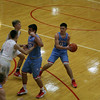 GREG KEIM | THE GOSHEN NEWS<br /> Junior Cole Harp of the Lakeland Lakers works the ball on offense as No. 23 junior Camron Bontrager set a screen for his teammate Tuesday in a game against the Plymouth Pilgrims in the Plymouth Shootout. Defending on the play for the Pilgrims is No. 12 sophomore Clah Hilliard.