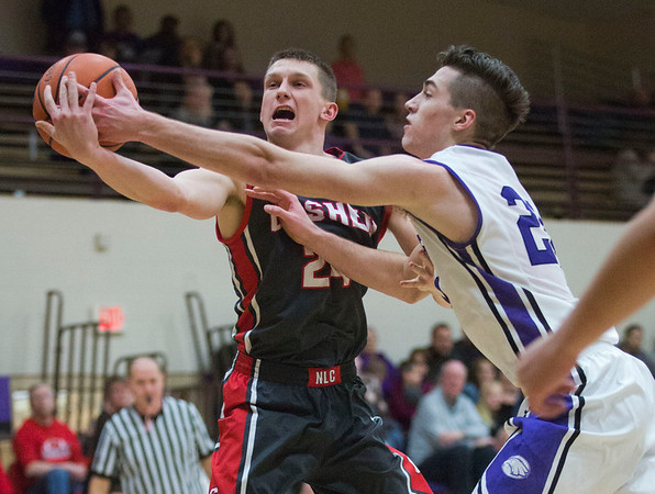 JAY YOUNG   THE GOSHEN NEWS<br /> Goshen High senior Mitchell Walters, left, battles for control of a rebound against Elkhart Christian Academy junior Weston Sage during their game Tuesday night in Elkhart.