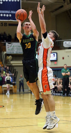 JAY YOUNG | THE GOSHEN NEWS<br /> Northridge junior Conner Utley (10) shoots a jumper around Warsaw senior Jaceb Burish (22) during their 4A sectional tournament game Wednesday night at Northside Gym in Elkhart.