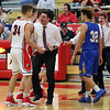 STEPHEN BROOKS | THE GOSHEN NEWS<br /> Goshen coach Michael Wohlford screams as his team returns to the bench after forcing overtime with a last-second shot in the consolation game of the Goshen Holiday Tourney against East Noble Friday at Goshen High School.