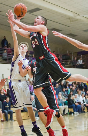 JAY YOUNG | THE GOSHEN NEWS<br /> Goshen High senior Mitchell Walters (24) scores against Elkhart Christian Academy junior Gabe Arter during their game Tuesday night in Elkhart.