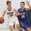 JAY YOUNG   THE GOSHEN NEWS<br /> Bethany Christian junior Kory Kern (12) is hounded by Triton sophomore Beau Hepler (14) as he brings the ball up the court to set the Bruins' offense during their game Tuesday night at Bethany.
