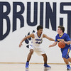 JAY YOUNG   THE GOSHEN NEWS<br /> Bethany Christian sophomore KeShawn Smith (40) pressures Triton senior Adam Stevens on defense during their game Tuesday night at Bethany.