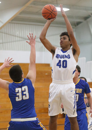 JAY YOUNG | THE GOSHEN NEWS<br /> Bethany Christian sophomore KeShawn Smith (40) pulls up for a jumper in front of Triton junior Dylan Hensley (33) during their game Tuesday night at Bethany.